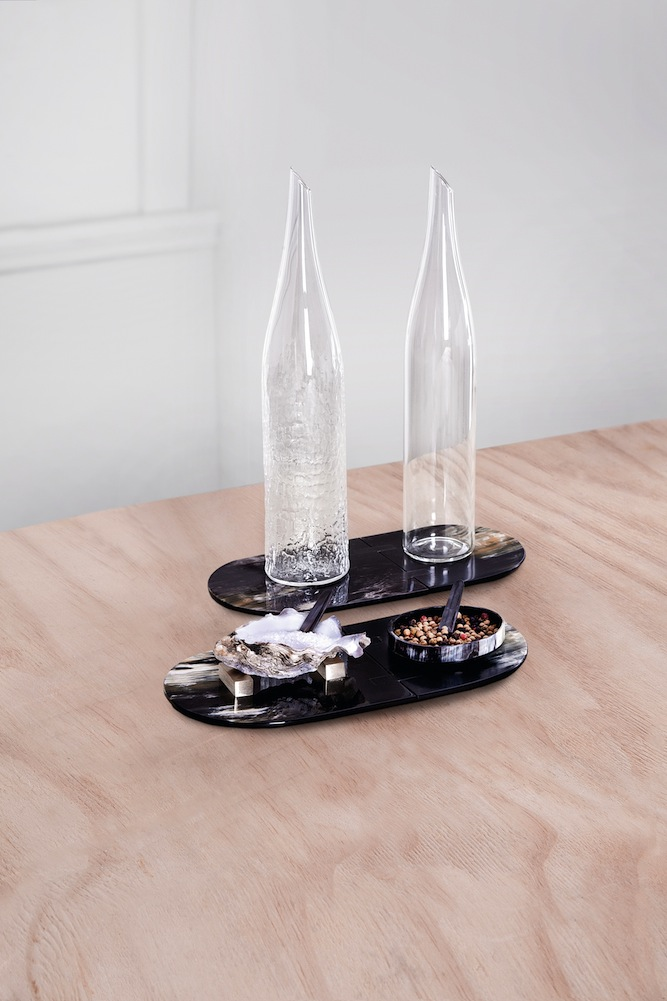 Raw, a tabletop service for oil-and-vinegar cruets and salt and pepper wells.