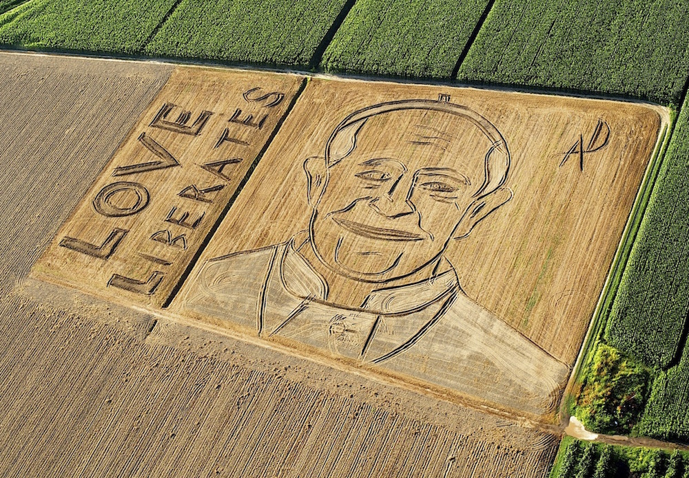 An aerial view of the image of Pope Francis by Italian artist Dario Gambarin is seen in a threshed wheat field in Castagnaro