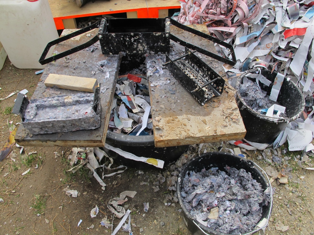 Arne Hendriks' makes bricks using newspaper for the Pigeon Poo Tower