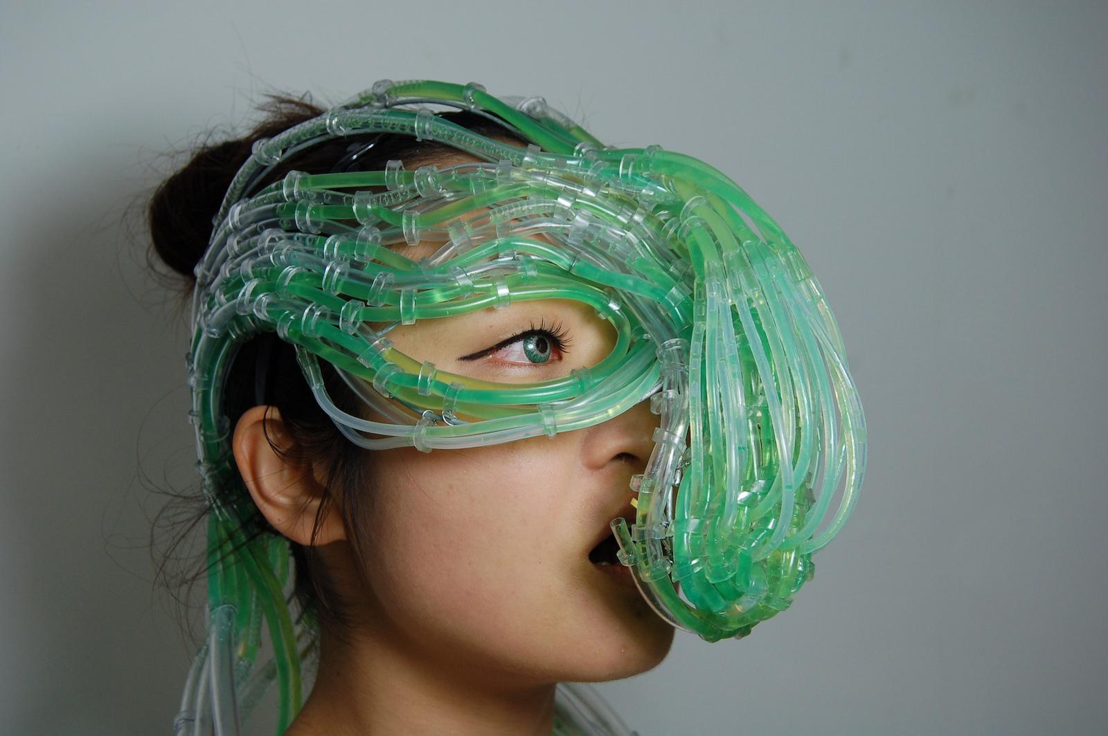 Near future algaculture symbiosis suit by London-based designers BurtonNitta.
